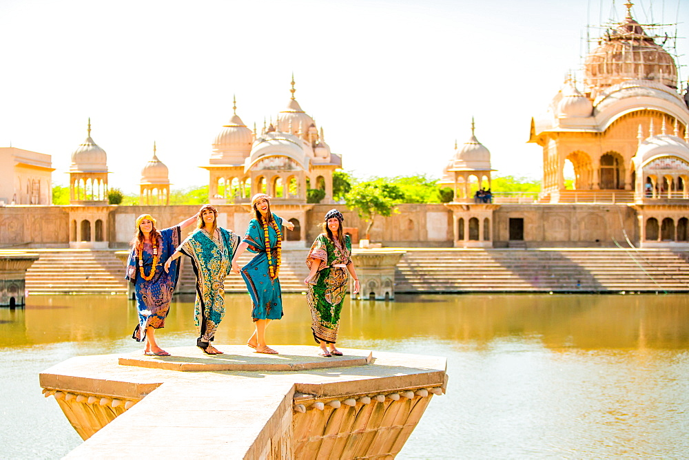 Female tourists stand in front of Temple during Holi Festival, Vrindavan, Uttar Pradesh, India, Asia