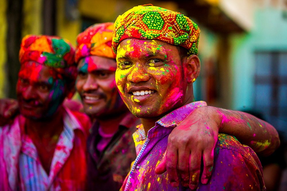 Men throwing colored pigment, Holi Festival, Vrindavan, Uttar Pradesh, India, Asia