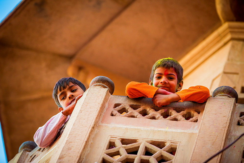 Children painted on a balcony during the Holi Festival, Vrindavan, Uttar Pradesh, India, Asia