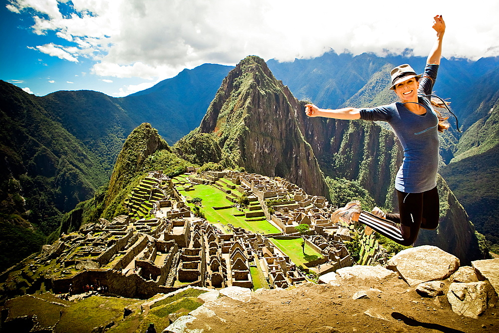 Laura Grier jumping at Machu Picchu ruins, Peru, South America
