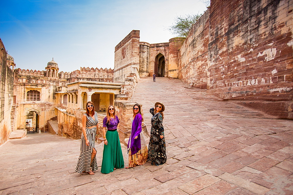 Tourists standing in the main gate of Mehrangarh Fort in Jodhpur, the Blue City, Rajasthan, India, Asia