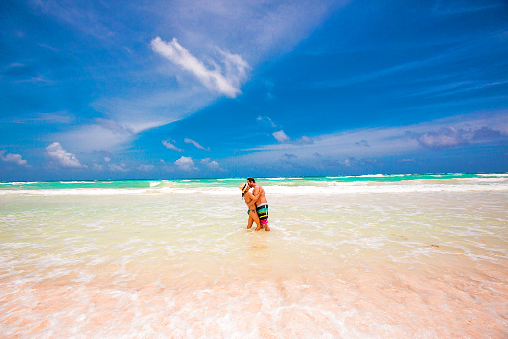 Romantic couple on the beach of Tulum, Mexico, North America