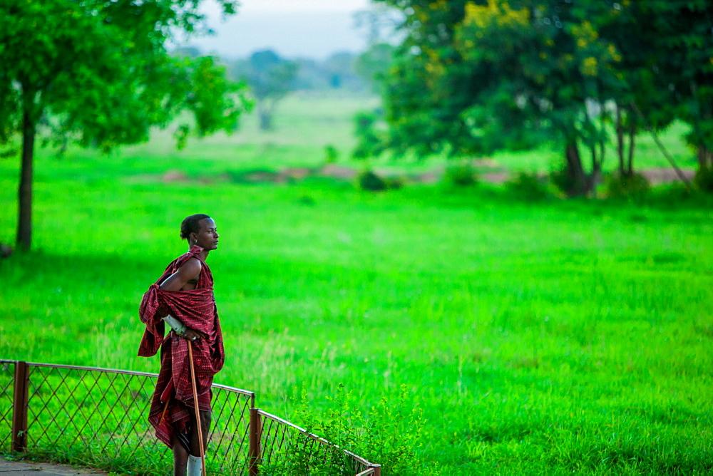 Maasai warrior stands guard, Mizumi Safari Park, Tanzania, East Africa, Africa