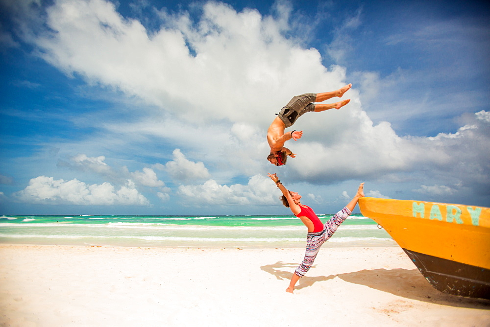Acrobatic couple balancing together on the beach of Tulum, Mexico, North America - 1218-381
