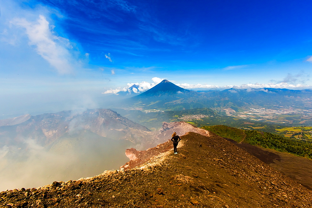 Cresting the peak of Pacaya Volcano in Guatemala City, Guatemala, Central America