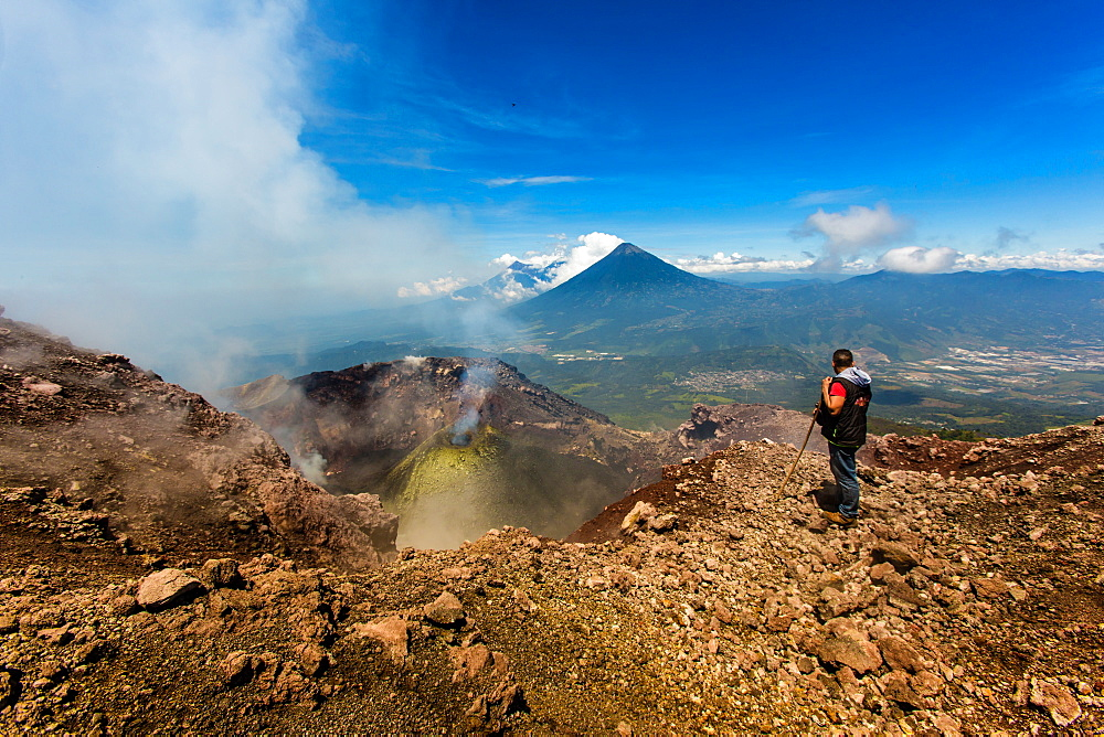Cresting the peak of Pacaya Volcano in Guatemala City, Guatemala, Central America