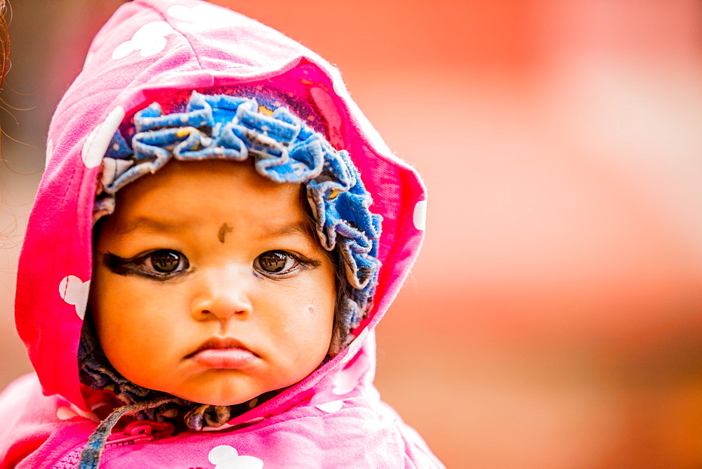 Baby with kohl-painted eyes, Kathmandu, Nepal, Asia