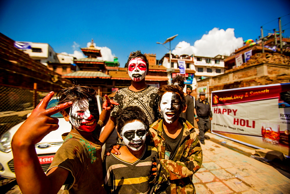 Kids with faces painted at the Holi Festival, Durbar Square, Kathmandu, Nepal, Asia