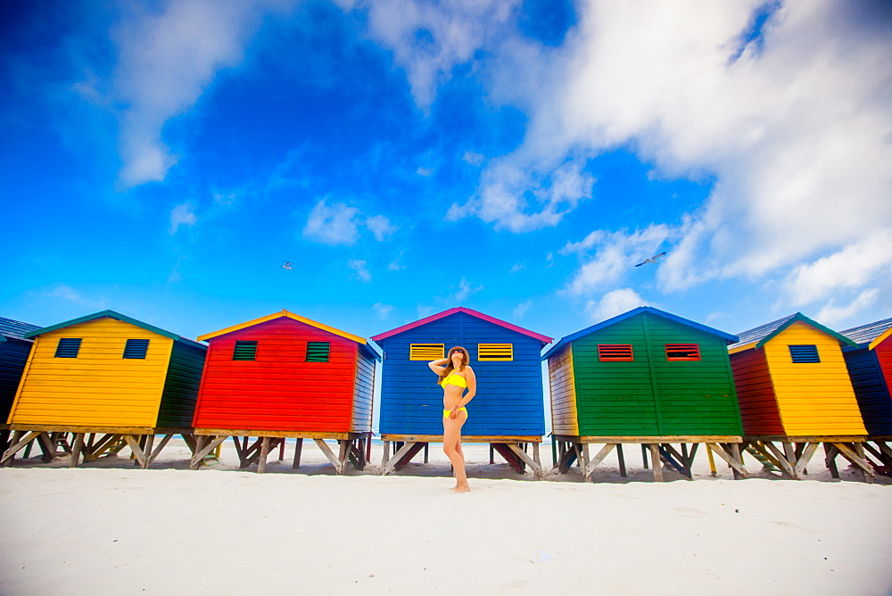 Girl in bikini, colorful beach huts, Muizenberg Beach, Cape Town, South Africa, Africa