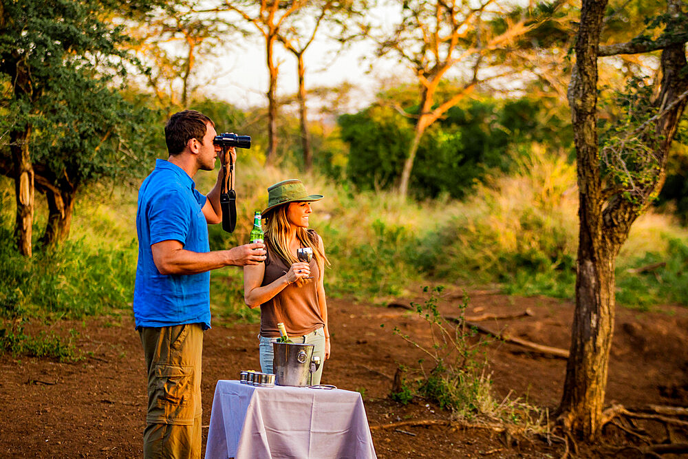 Couple enjoying view at a safari camp, Zululand, South Africa - 1218-713