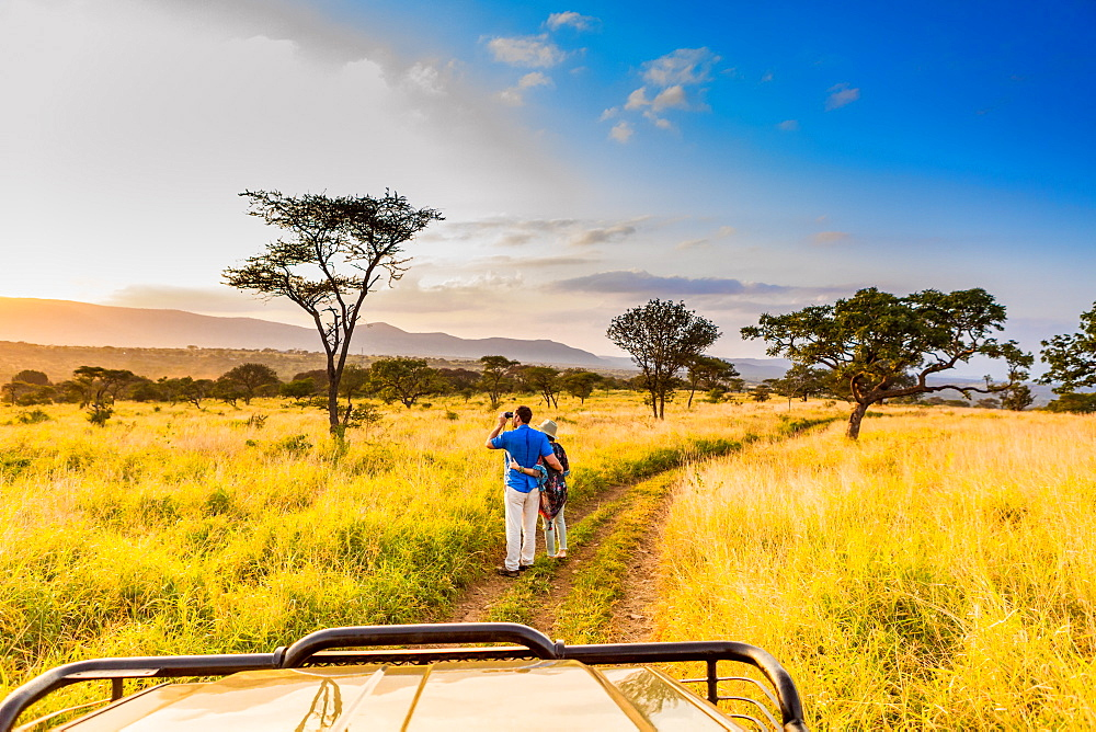 Couple enjoying view at a safari camp, Zululand, South Africa, Africa