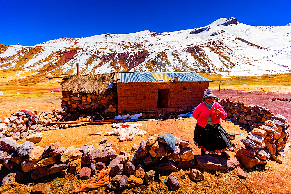 A woman by her shack on Rainbow Mountain, The Andes, Peru, South America - 1218-728