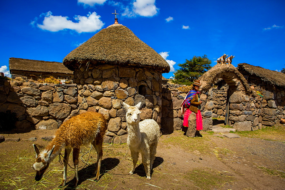 Woman standing at her home in Llacon, Lake Titicaca, Peru, South America