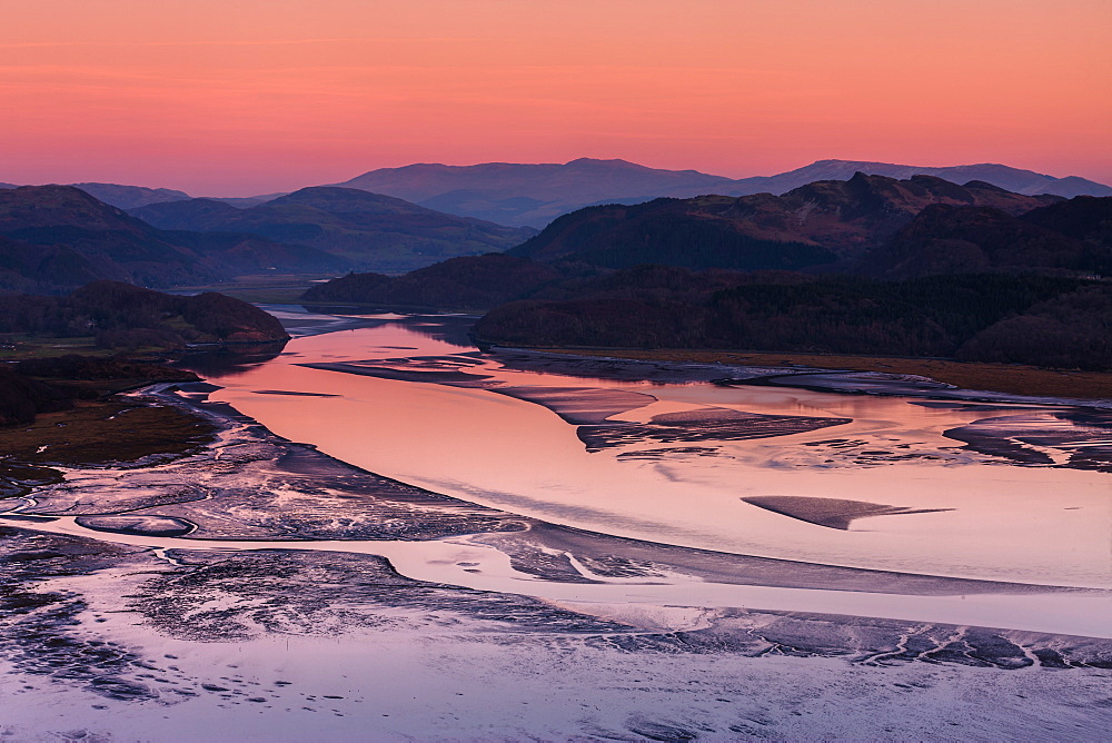 Twilight and low tide on the calm Mawddach estuary bordered by the mountains within Snowdonia National Park, Gwynedd, Wales, United Kingdom, Europe