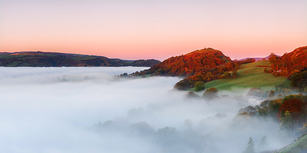 The medieval castle Dinas Bran perched above the cloud inversion lying in the River Dee valley on a clear autumn morning, Denbighshire, Wales, United Kingdom, Europe