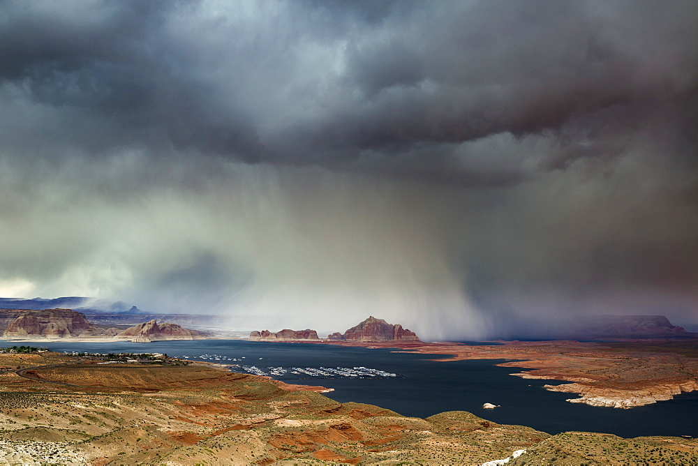 A storm obscures Grand Staircase-Escalante National Monument as it sweeps across Lake Powell and Wahweap Bay, Page, Arizona, United States of America, North America