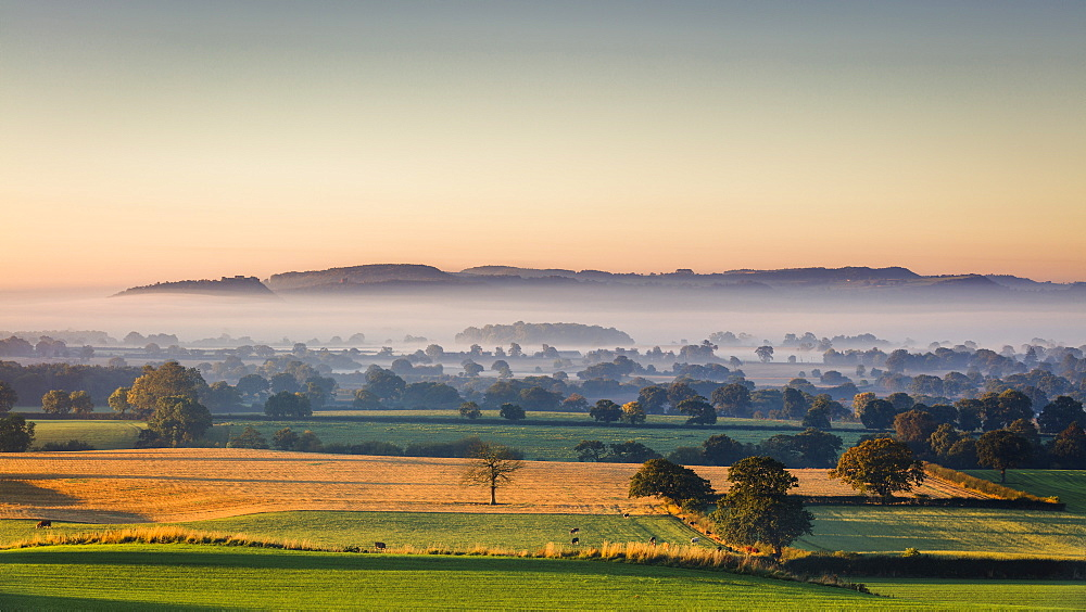 Low autumn morning light rakes across the Cheshire plain with Beeston Castle and the Peckforton sandstone ridge beyond, Cheshire, England, United Kingdom, Europe - 1219-118