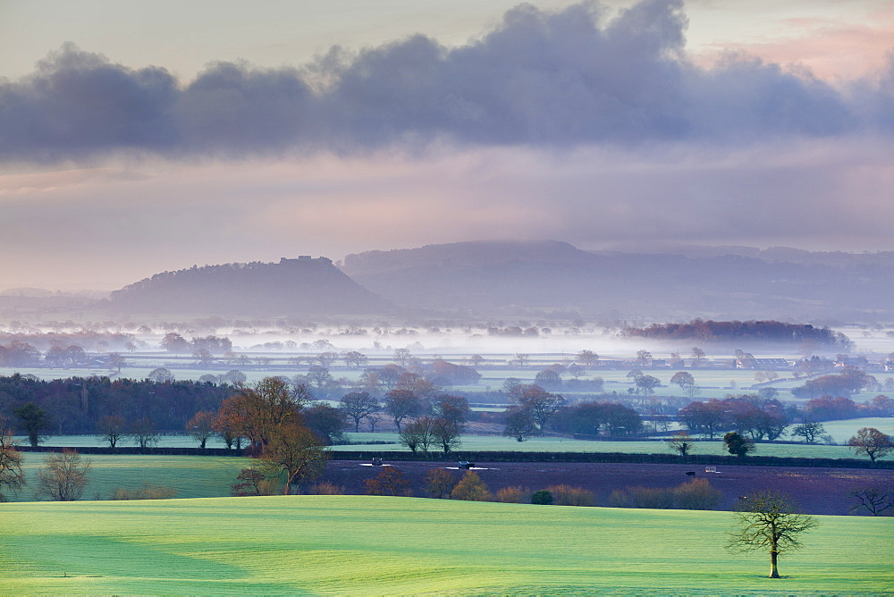 Low winter light rakes across the Cheshire plain with Beeston Castle and the Peckforton sandstone ridge beyond, Cheshire, England, United Kingdom, Europe - 1219-119