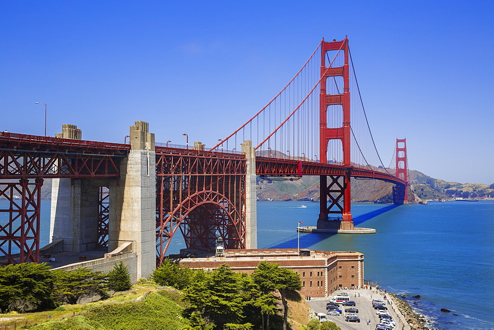 Looking across the San Francisco Golden Gate Bridge with Fort George in the foreground at the edge of the Pacific Ocean, California, United States of America, North America