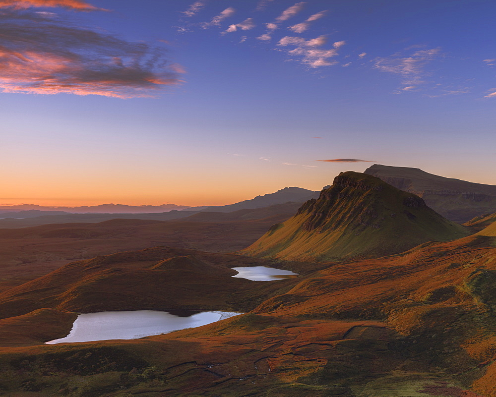 Looking south along the Trotternish peninsula to Cleat with the sun raking across the landscape on the Isle of Skye, Inner Hebrides, Scotland, United Kingdom, Europe - 1219-175