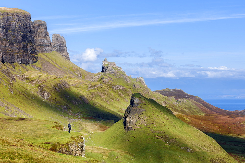 Looking out over the Quirang on the Trotternish ridge and beyond to the Isle of Harris in the Scottish Highlands, Isle of Skye, Inner Hebrides, Scotland, United Kingdom, Europe - 1219-178