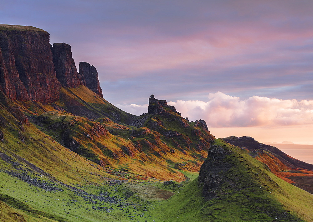 Early morning dawn light hits the Quiraing in the Trotternish peninsula on the Isle of Skye, Inner Hebrides, Scotland, United Kingdom, Europe - 1219-181