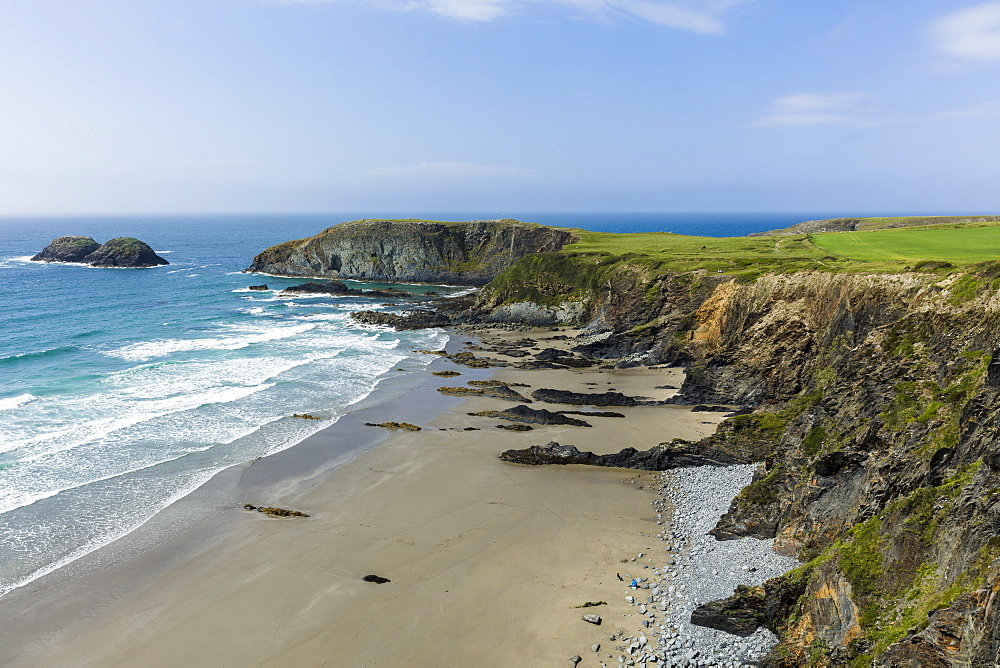 A beach along the Pembrokeshire Coast National Park with the coastal path running along the cliff tops above, Wales, United Kingdom, Europe