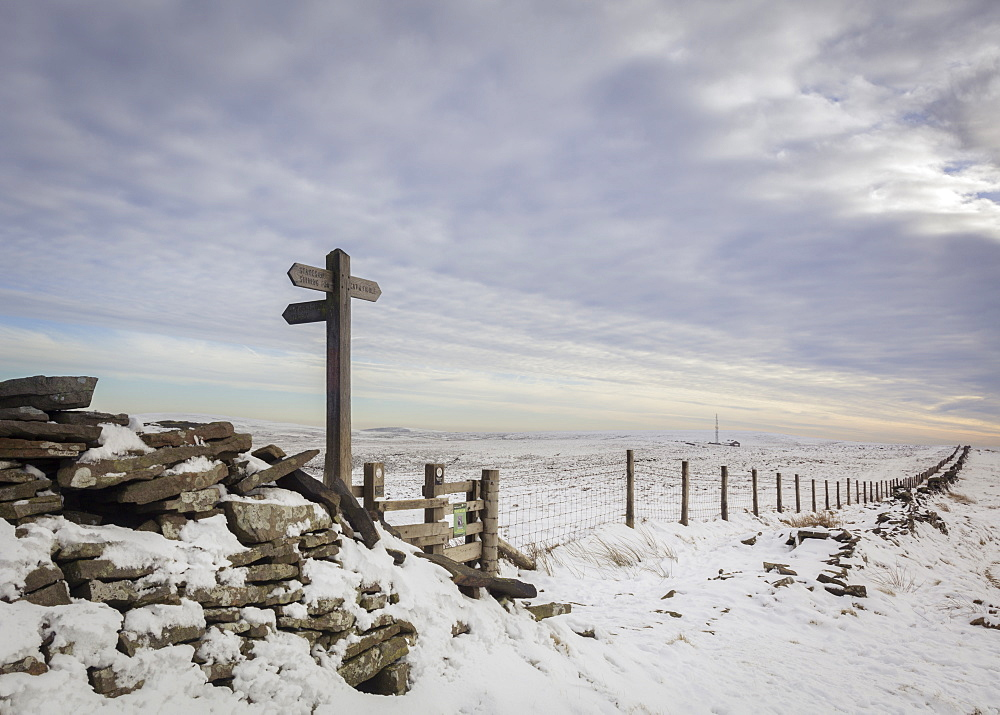 Looking across snow covered fields in the Peak District to the Cat and Fiddle Inn in the White Peak, Cheshire, England, United Kingdom, Europe - 1219-229