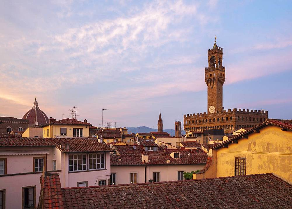 Looking over the rooftops of the historic centre of Florence to the Palazzo Vecchio at dusk, Florence, UNESCO World Heritage Site, Tuscany, Italy, Europe - 1219-245