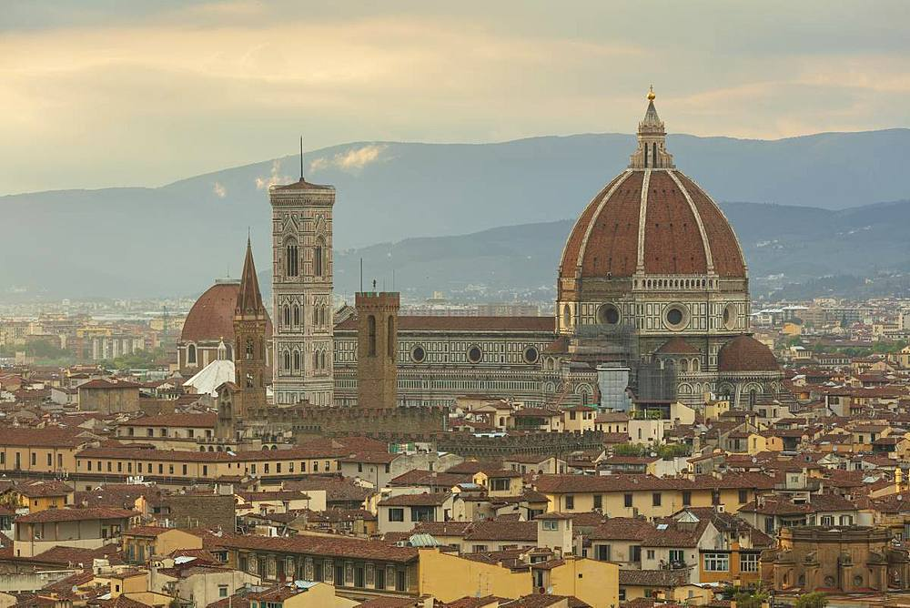 Looking over Florence to the landmarks of the Duomo, Campanile and Baptistry with the Apennine mountains beyond.