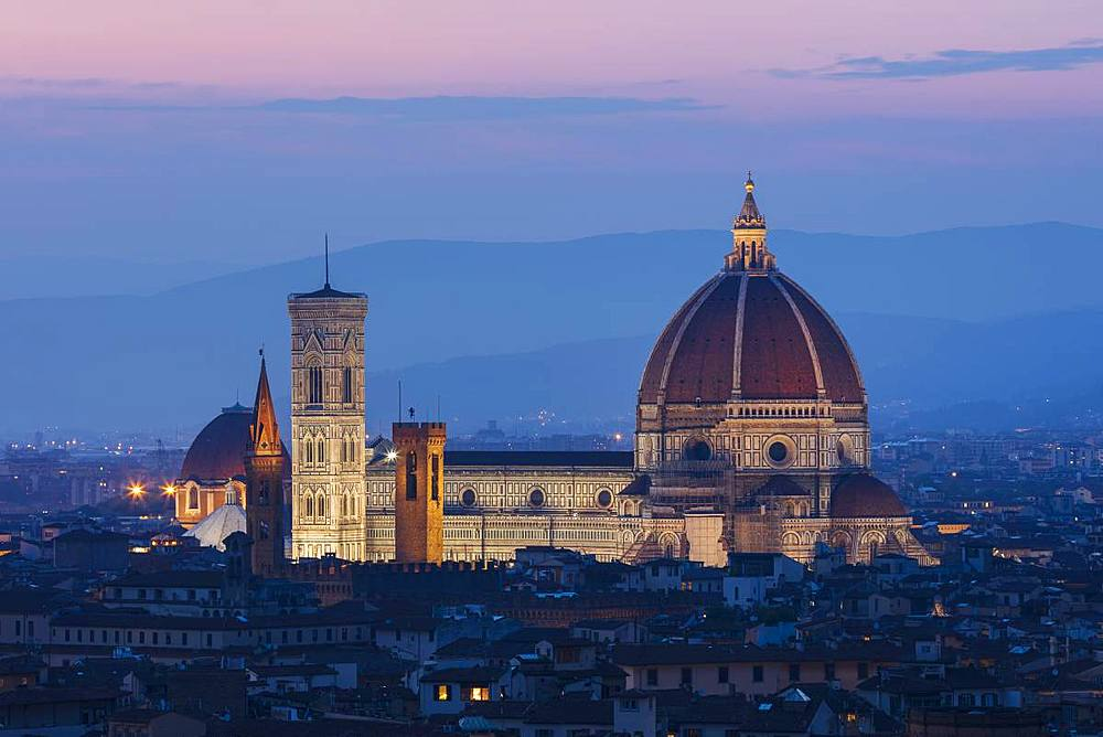 Looking over Florence to the landmarks of the Duomo, Campanile and Baptistry lit in the early evening light.