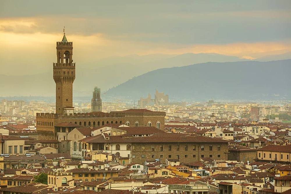 Looking across the rooftops of central Florence to The Palazzo Vecchio and the distant Apennine mountains, Florence, Tuscany, Italy, Europe - 1219-249
