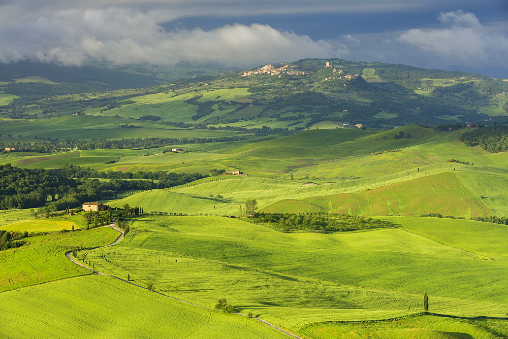 Looking across the Val d'Orcia to the historic towns of Rocca d'Orcia and Castiglione d'Orcia with clouds lingering beyond, UNESCO World Heritage Site, Tuscany, Italy, Europe - 1219-267