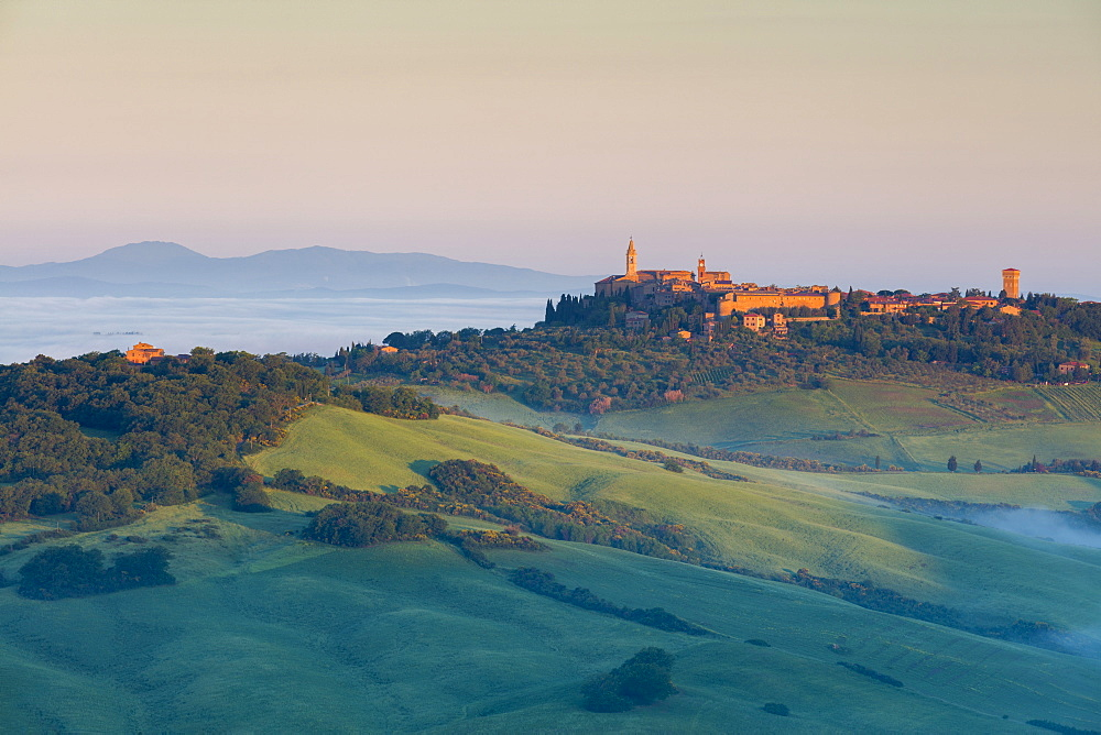 First light of the day hits the historic town of Pienza with cloud covering the Val d'Orcia beyond, UNESCO World Heritage Site, Tuscany, Italy, Europe