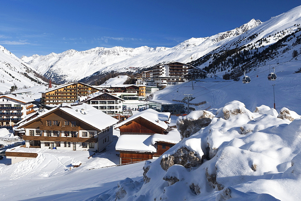 The village of Obergurgl sat below the huge peaks of the Otztal Alps and covered by winter snow, Tyrol, Austria, Europe