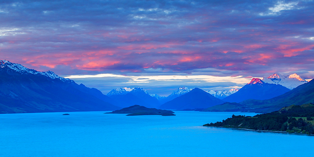 Mount Earnslaw and neighbouring mountain peaks in the Southern Alps are lit with the last rays of the sun beyond Lake Wakatipu, Otago, South Island, New Zealand, Pacific - 1219-66
