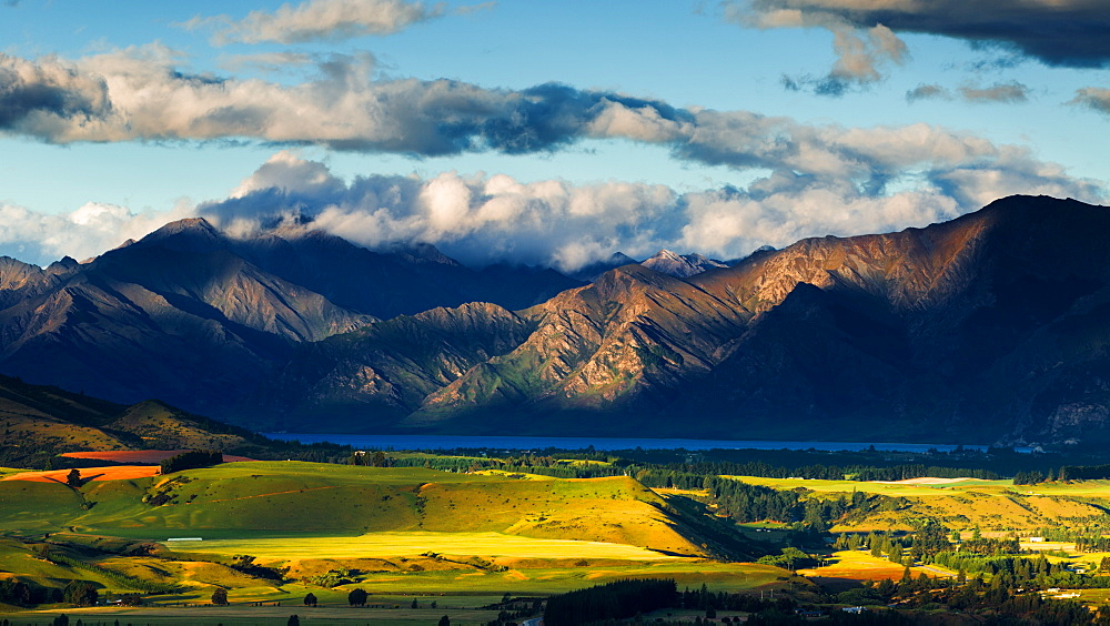 The plains and lakes of Otago region framed by cloud capped mountains, Otago, South Island, New Zealand, Pacific - 1219-77