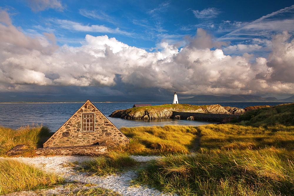 Boathouse and Twr Mawr lighthouse on Llanddwyn Island, Anglesey, Wales, United Kingdom, Europe
