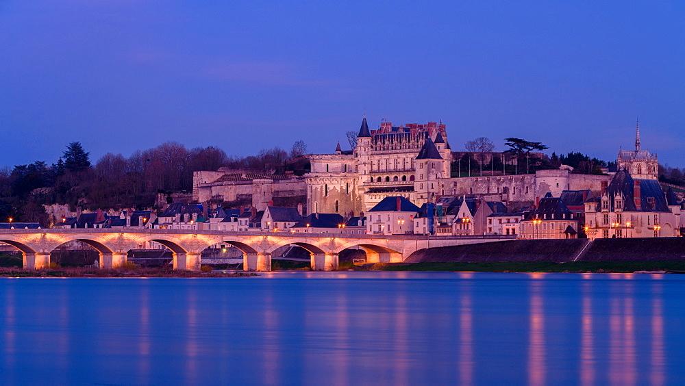 Royal chateau of Amboise lit at dusk on the banks of River Loire, Loire Valley, UNESCO World Heritage Site, Indre et Loire, Pays de la Loire, Centre, France, Europe