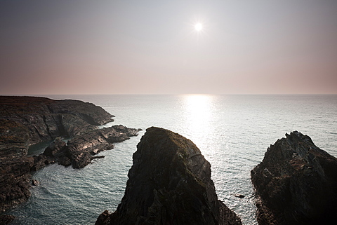Late afternoon misty sunlight over cliffs near South Stack, Ynys Lawd, North Anglesey, Wales, United Kingdom, Europe