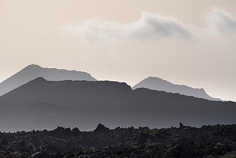 Dusk haze from Moroccon trade winds, partially softening the volcanoes of Timanfaya National Park (Fire Mountain), Lanzarote, Canary Islands, Spain, Europe
