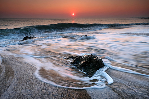 Waves and rocks at sunset, Rhosneigr, Anglesey, Wales, United Kingdom, Europe