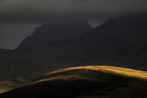 Tryfan and a sunlit Moel Cynghorion in the foreground, Snowdonia, Wales, United Kingdom, Europe