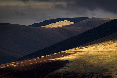 Glimpses of sunshine across successive hillsides in the heart of Snowdonia, with Bera Mawr in sunlight, Snowdonia, Wales, United Kingdom, Europe
