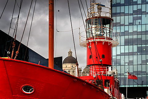 An old lightship in Liverpool's Albert Dock contrasting against ultra modern and traditional architecture behind, Liverpool, Merseyside, England, United Kingdom, Europe