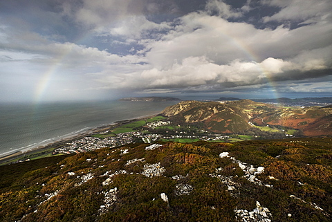 Huge rainbow arching from the Irish Sea to the Sychnant Pass, Conwy with the Great Orme and Llandudno in the background, Gwynedd, Wales, United Kingdom, Europe