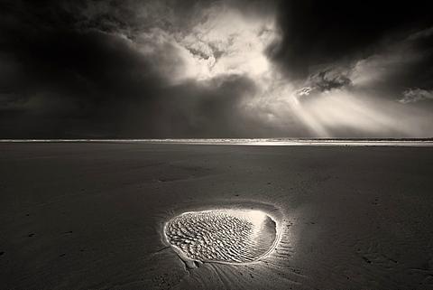 Break in the storm clouds over Llanddwyn Beach, Caernarfon Bay, Irish Sea, West Anglesey, Wales, United Kingdom, Europe