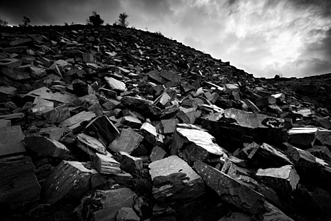 Mountainsides are blasted away here in North Wales to extract high quality slate and new hills created from the waste, Snowdonia, Wales, United Kingdom, Europe