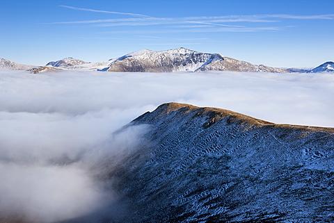Yr Wyddfa (Snowdon) mountain summit in North Wales in winter, above a phenomenal temperature inversion, Snowdonia, Wales, United Kingdom, Europe
