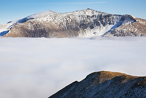 Yr Wyddfa (Snowdon) above a phenomenal temperature inversion in North Wales, leaving only Snowdonia's peaks above the fog, Wales, United Kingdom, Europe